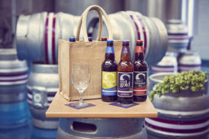 6 pack jute bag of bottled ales and Swan Brewery glass